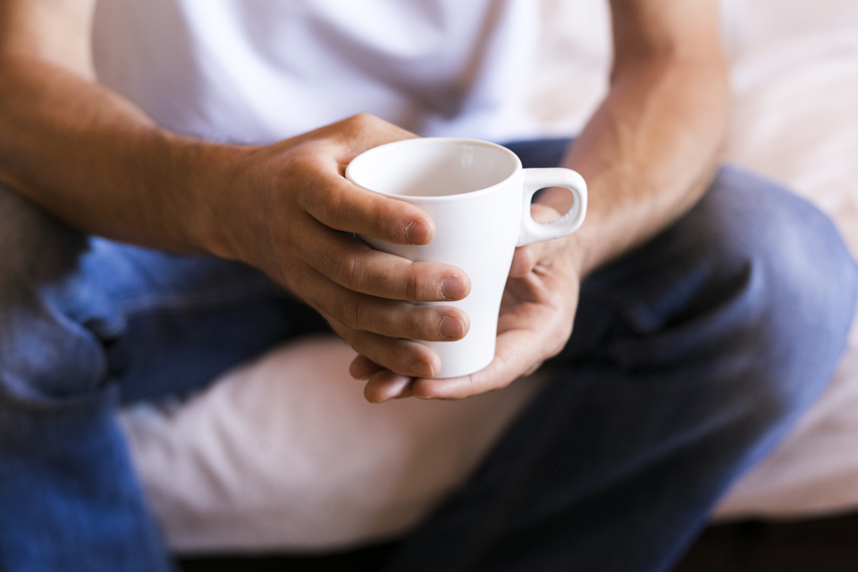 Man Holding Cup