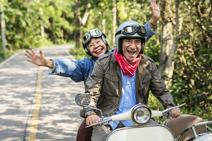 Older Couple on Motorbike